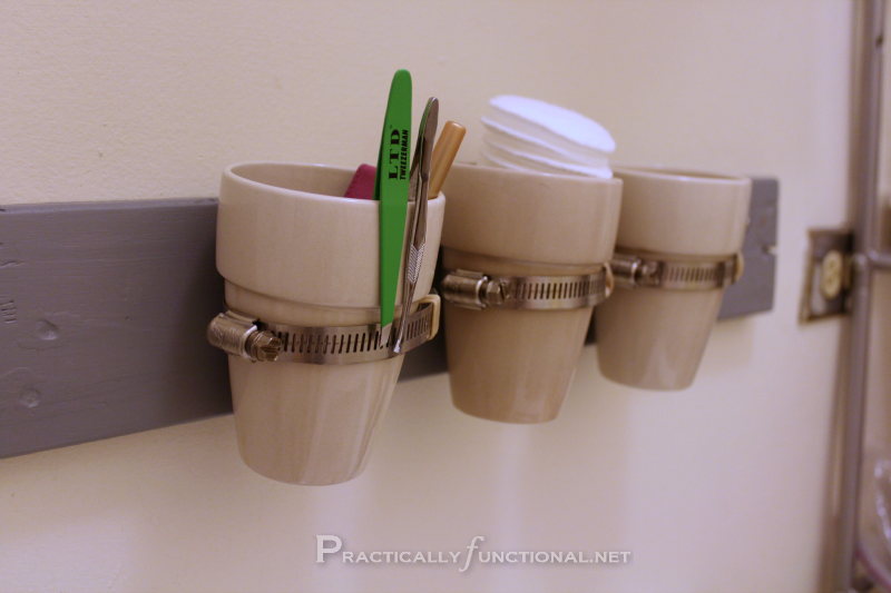 Bathroom Storage With Mini Flower Pots Wood And Pipe Clamps