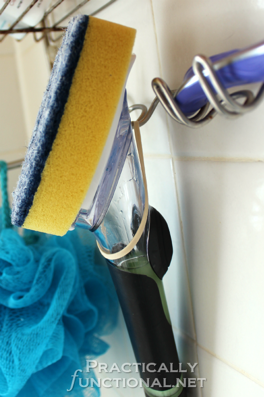 Use a rubberband to hang a dish brush in the shower for easy cleaning