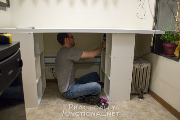 Make your own built-in craft desk with a door and storage cube shelves - Screw up through the top of the shelves into the door to hold it all together