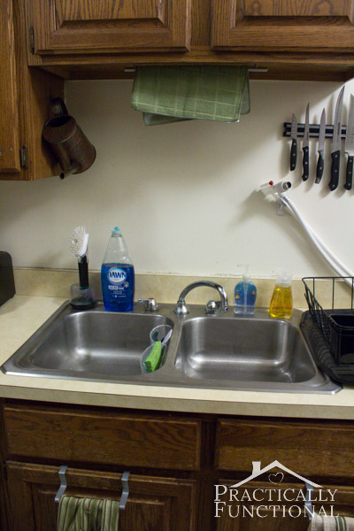 "Kitchen Tour: Use the area around the sink as a ""command center"" and keep your useful kitchen items close at hand"