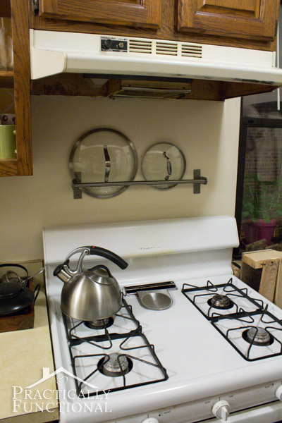 Kitchen Tour: Hang a towel bar near your stove to store pot lids when you take them off the pans on the stove