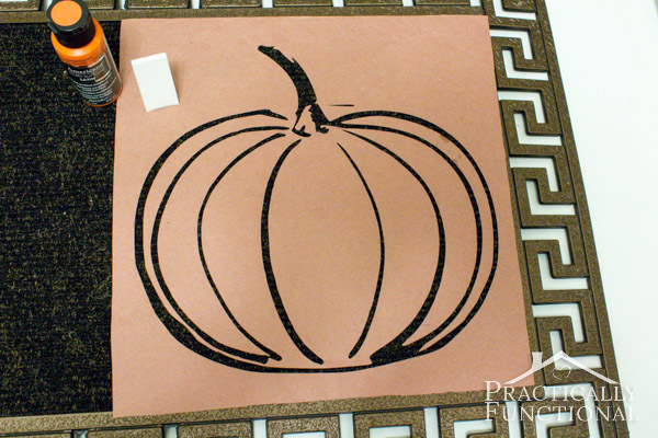 DIY Stenciled Fall Welcome Mat: Use spray adhesive to attach a kraft paper stencil