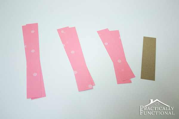 Paper Heart Garland: Make your own Valentine's Day decor in under fifteen minutes using only paper and string!