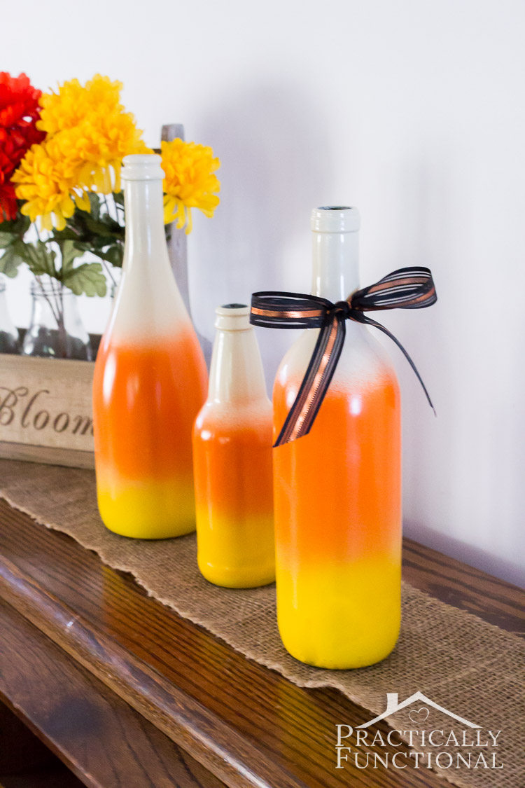 These DIY painted candy corn bottles are too cute! So easy to make too!