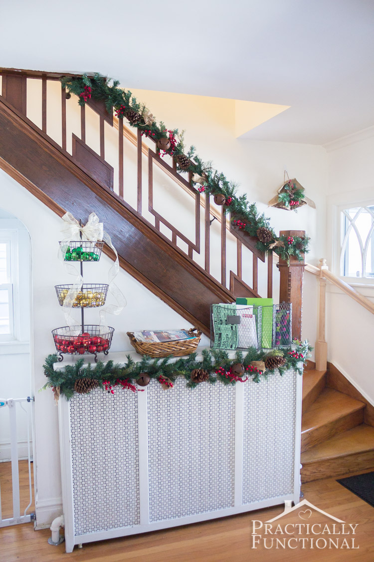 Christmas stairway decor: Make your entryway inviting by adding a garland to your stairway!