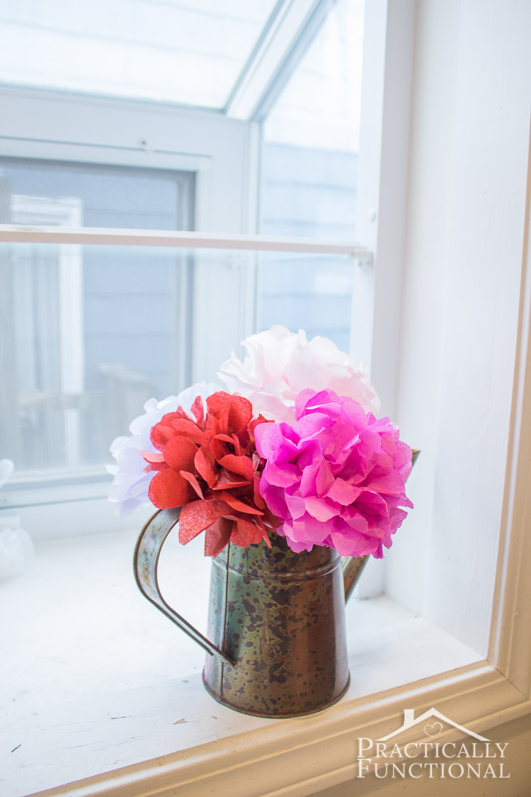 These DIY tissue paper flowers are a quick and easy way to brighten up a room! Perfect for Valentine's Day or any occasion!