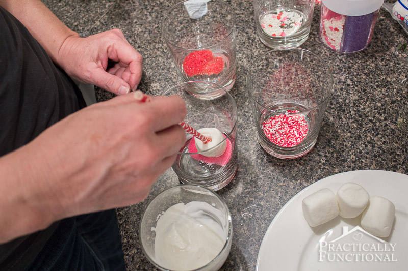 Candy Covered Valentines Marshmallow Pops dip the marshmallow pop in sprinkles