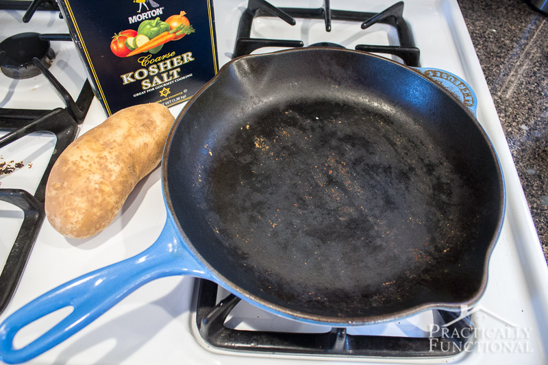 How to clean and season a dirty or rusty cast iron pan using kosher salt and a potato
