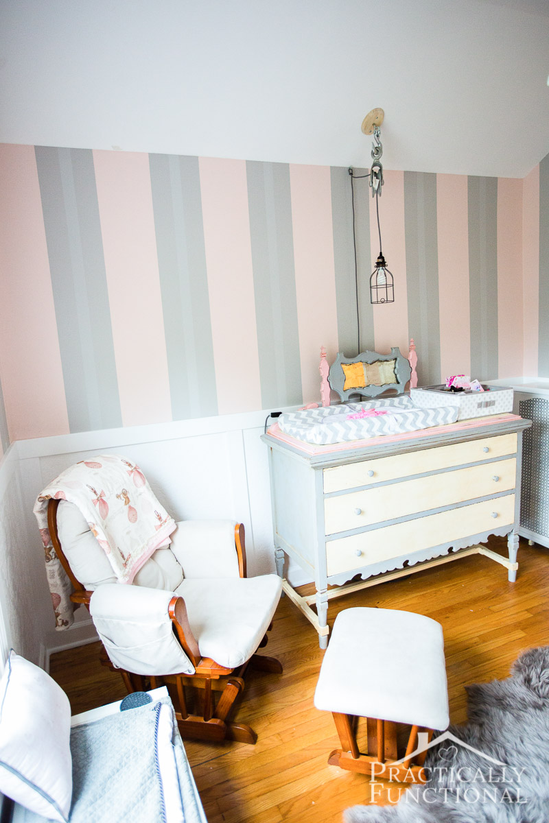 AJ's DIY steampunk nursery! Still a work-in-progress, but check out how we painted the walls in three sets of pink and grey stripes!