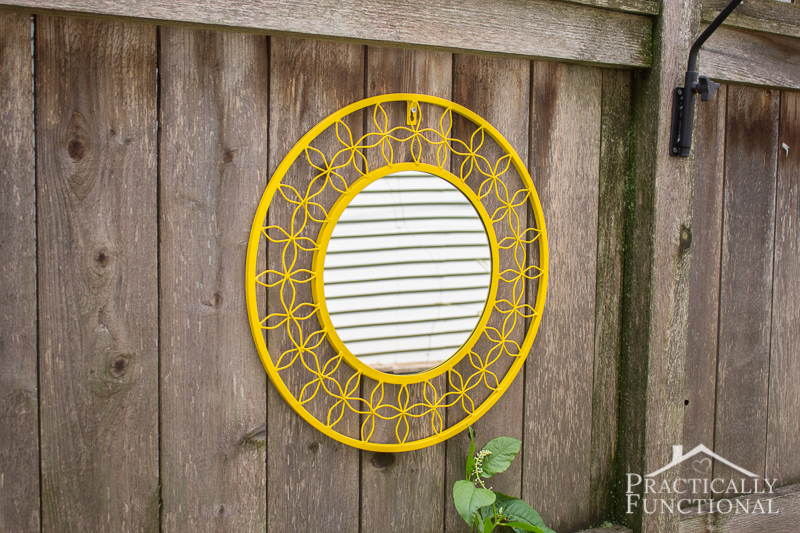 Bring some color to your yard by spray painting a mirror for your fence!
