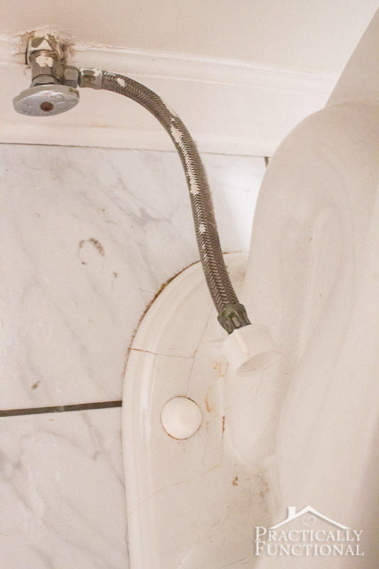 Remove the water supply line from the toilet tank