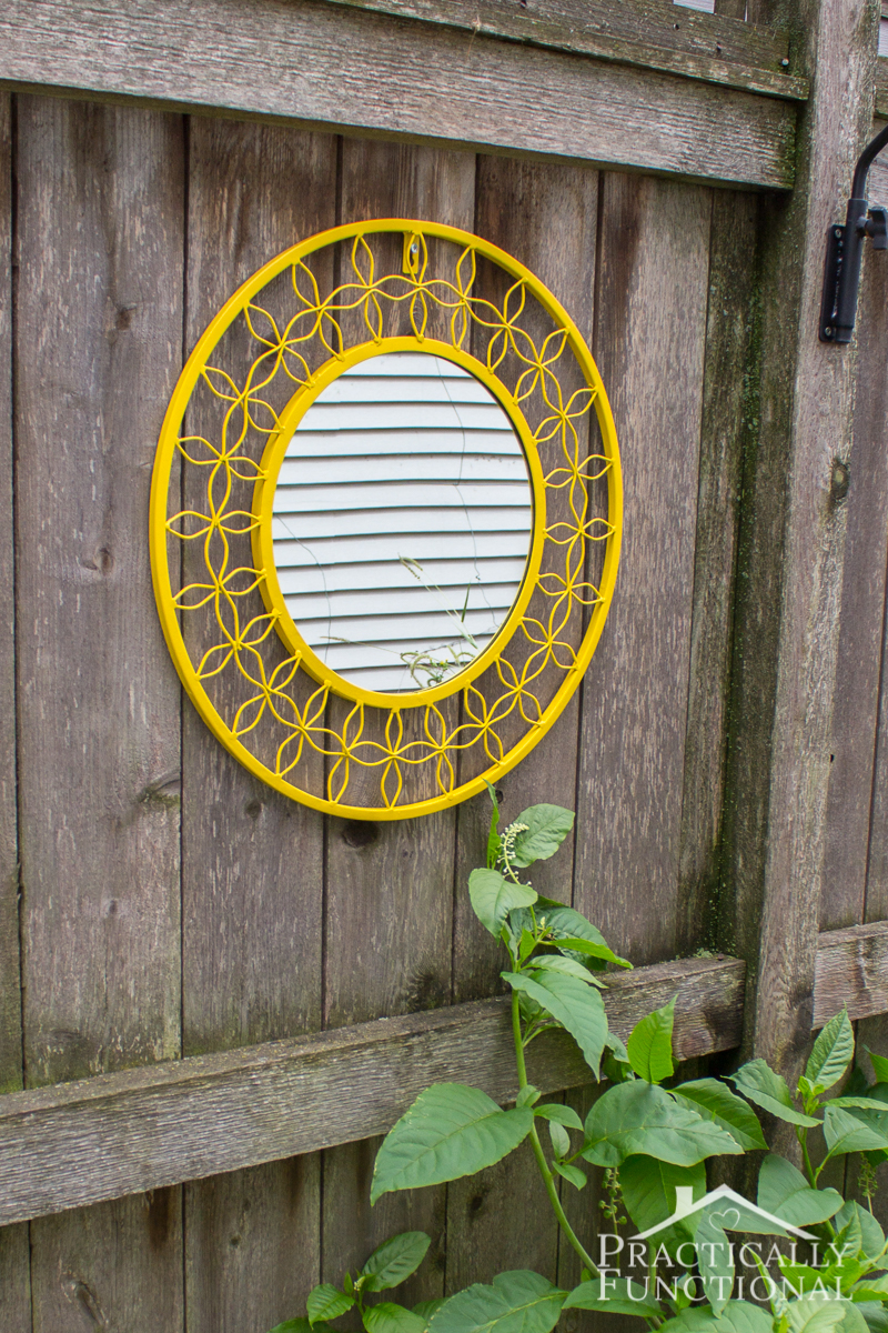Update an old mirror with a coat of bright spray paint for a fun pop of color in your yard!