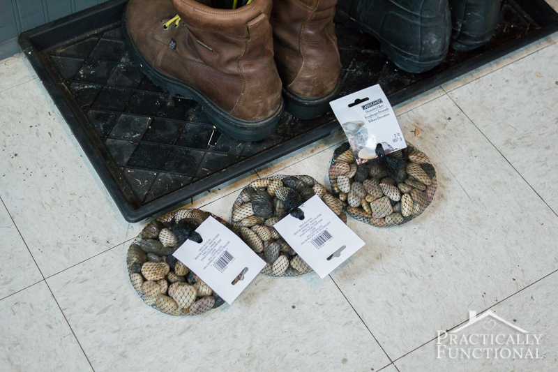 Add river rocks to a boot tray to give it a quick makeover