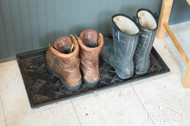 Give a boring boot tray a simple makeover by adding river rocks