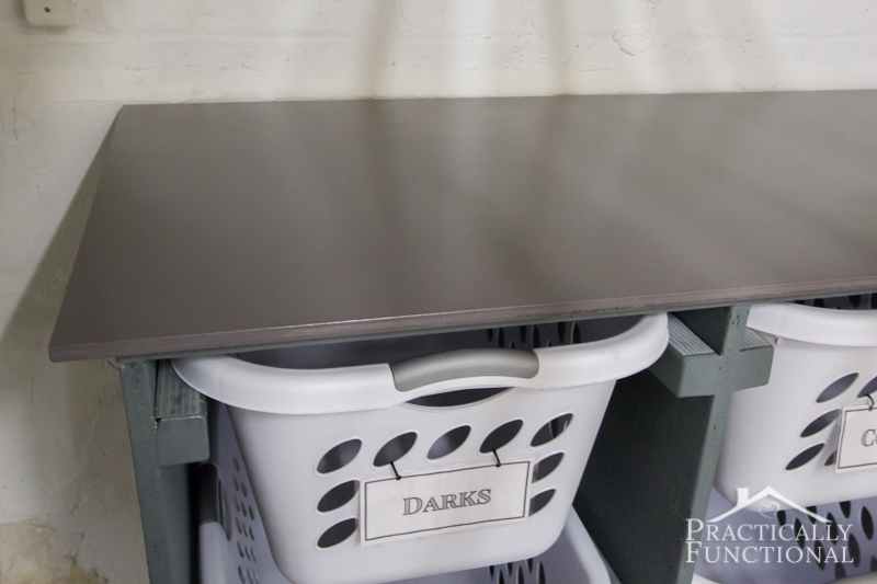 Simple DIY Laundry Basket Dresser stained and sealed top piece doubles as a folding and sorting station