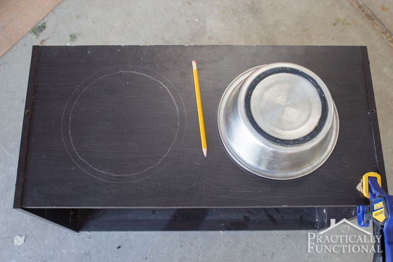 Trace your dog bowls on the top of the dresser to figure out where to cut