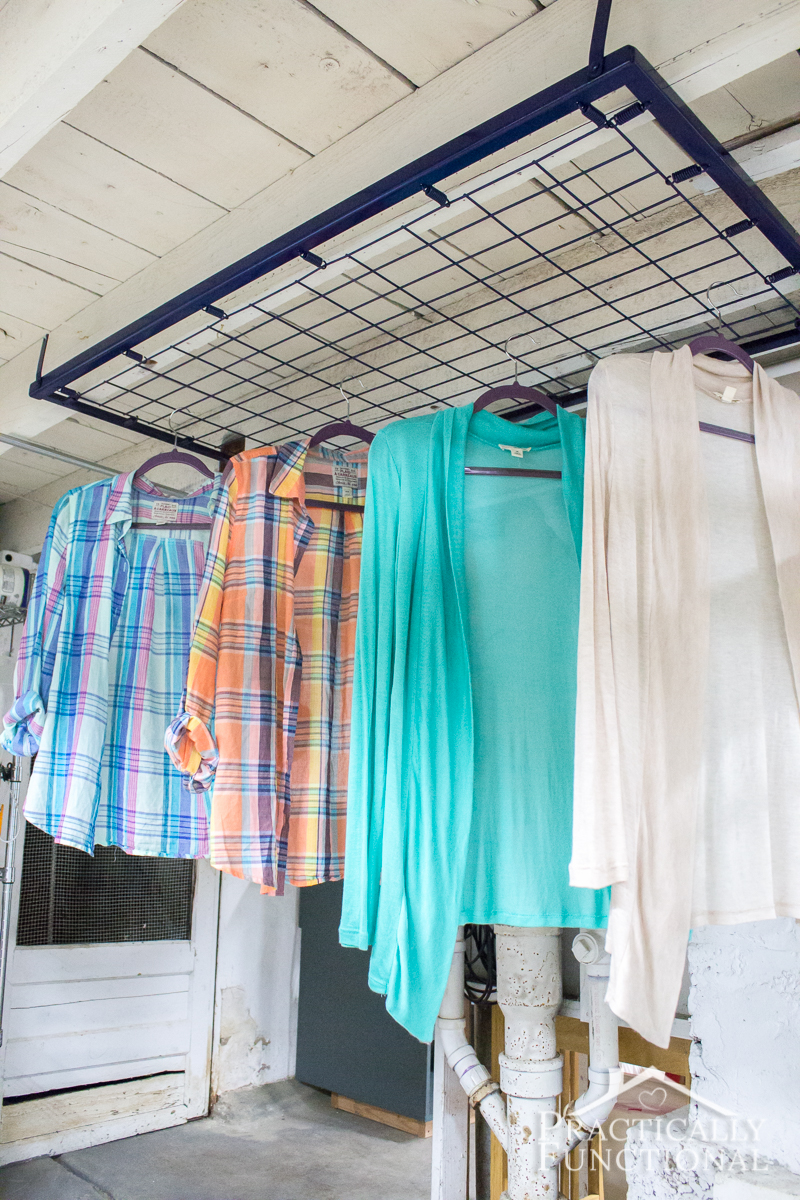 Turn an old crib spring into drying rack for your laundry room!