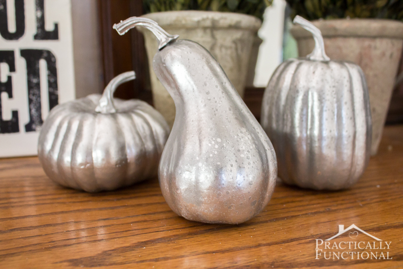 Make your own faux mercury glass pumpkins from foam dollar store pumpkins! All you need is spray paint and a squirt bottle with water and vinegar in it!