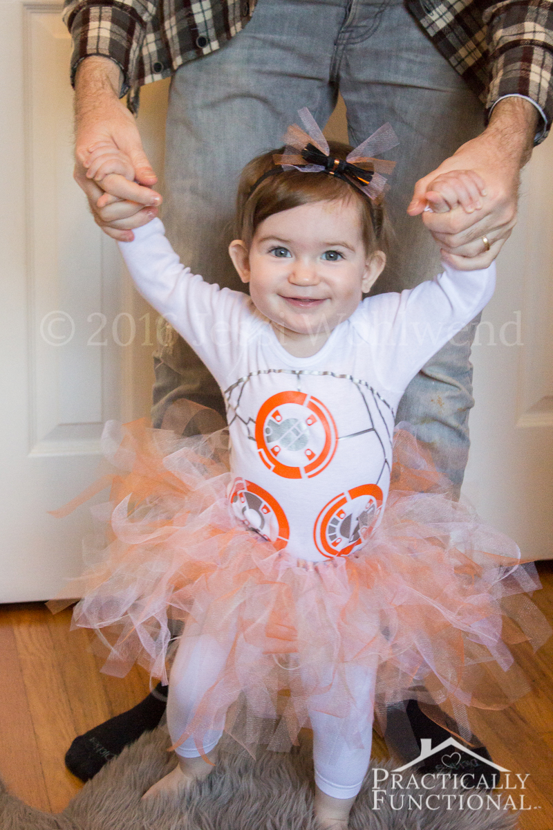 This DIY BB8 costume is too cute! It's just a plain onesie with graphics on it and a simple no-sew tutu!