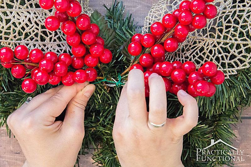 Attach greenery picks to the wreath using floral wire to secure them